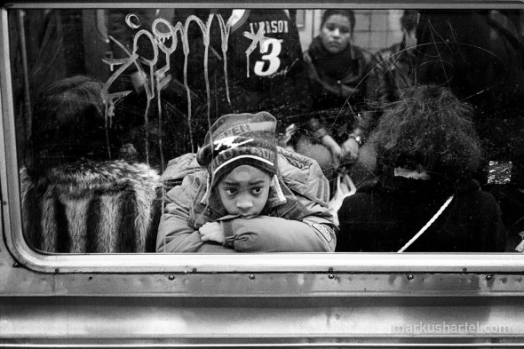 Thoughtful, subway NYC, street photography by Markus Hartel, New York