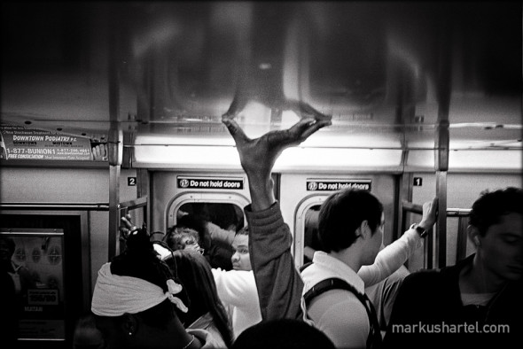 Straphangers, subway NYC - street photography by Markus Hartel, New York