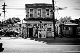 Men relaxing outside a Liquor Store, New Orleans